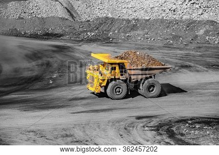 Big Yellow Mining Truck Transportation Of Gold Ore. Open Pit Mine Industry