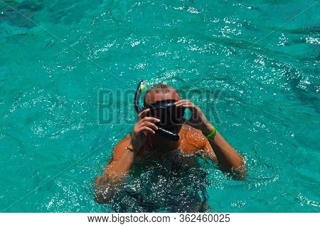 Scuba Diver,  On The Water In A Mask With Snorkel In A Sunny Day