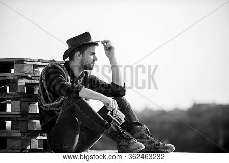 Let Him Ride A Horse. Wild West Rodeo. Thoughtful Man In Hat Drink Whiskey. Western Cowboy. Vintage