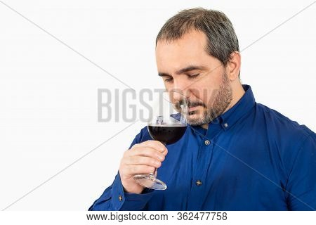Man Smelling A Glass Of Wine On White Background