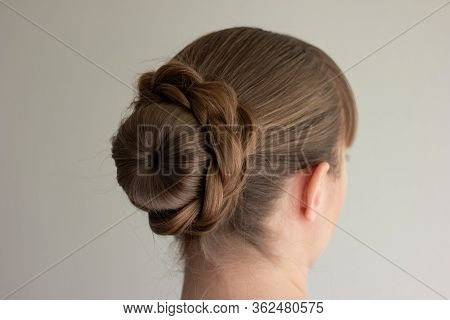 Young Caucasian Woman With Blonde Hair Wearing A Self-made French Bun Back Side View No Face Unrecog