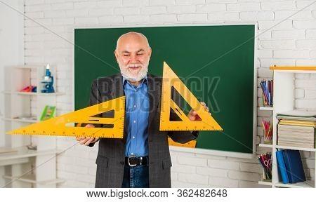 Stem Subjects. Let Me Explain. Customized Learning Experiences. Senior Intelligent Man Teacher At Ch