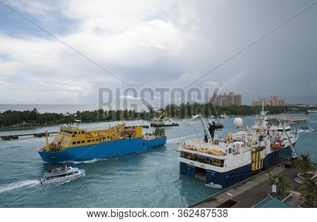 The Aerial View Of An Industrial Ship Passing By In Nassau Harbour Under Heavy Skies (nassau, Bahama