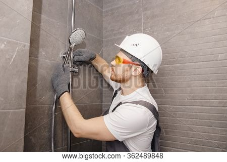 Plumber Installing Shower Stall, Work In Bathroom