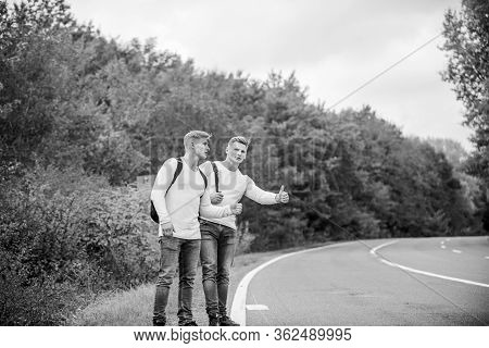 Hitchhiking Gesture. Begin Great Adventure In Your Life With Hitchhiking. Company Friends Travelers