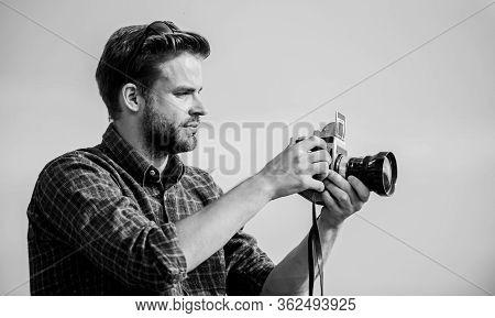 Guy Outdoors Blue Sky Background. Vintage Equipment. Blogger Shooting Vlog. Vacation Time. Handsome