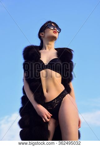 Hey Cutie. Sexy Woman Wear Erotic Lingerie And Fur Waistcoat. Sensual Girl In Summer Sunglasses On S