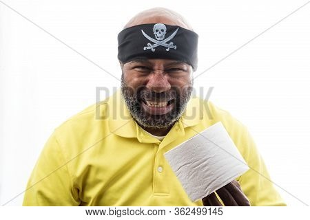 African American Man With Toilet Paper And Pitate Bandanna.  Covid 19 Concept Of Lockdown, Flatten T