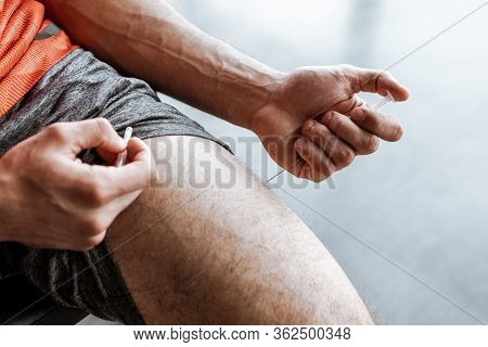Cropped View Of Sportsman Making Forbidden Doping Injection In Leg