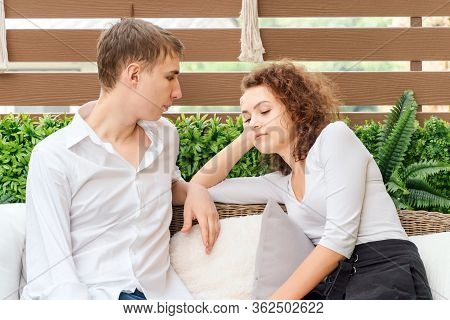 Young Couple Sitting In The House And Feeling Depress Stress. They Stay Isolation At Home For Self Q