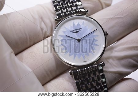 Saint-imier, Switzerland 31.03.2020 - Closeup Image Of Longines Watch In The Male Palm In A White Gl