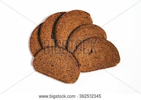 Sliced Slices Of Bread Isolated On White. Wholemeal Bread. Top View Of Sliced Bread.