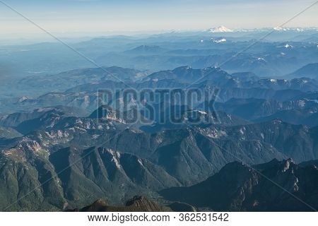 An Aerial View Of Washington State With Mt Rainier Off In The Distance.