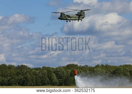 Volkel Netherlands June 13 2019: Royal Netherlands Air Force Chinook Demonstrating Firefighting With