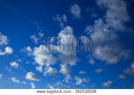 Beautiful Clouds Scattered Across The Blue Sky. Small, Cottony White Clouds.