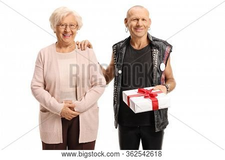Elderly woman with a punk man holding a present and smiling isolated on white background