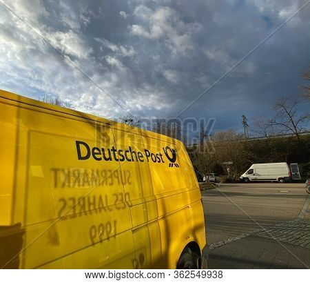 Munich, Germany - Feb 2, 2020: Side View Of Yellow Volkskwagen Deutche Post Dhl Postal Distribution
