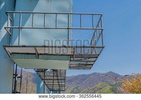 Gangplank Over Gantry Hoist Of Hoist Deck On Spillway Of Local Dam.