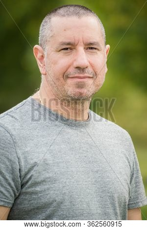 Portrait Of A Middle Aged Man With Short Hair, Outdoor