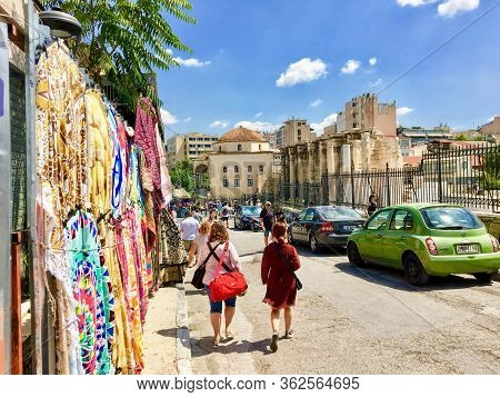 Athens, Greece - July 12th 2019: A Beautiful Sunny Summer Day With Tourists Exploring The Interestin