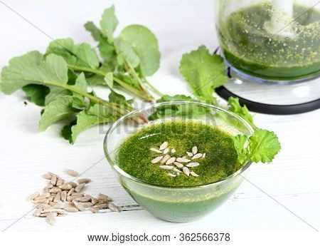Mixed Organic Radish Leaves With Sunflower Seeds. Healthy And Cheap Smoothie In A Bowl On White Wood