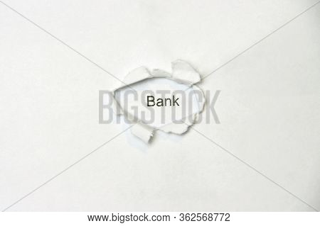 Word Bank On White Isolated Background, The Inscription Through The Wound Hole In The Paper. Stock P