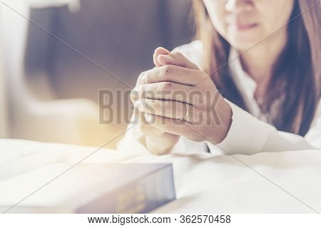 Holy Bible Prayer Believe In God Church. Woman Hands Pray Christian Bible For God Blessing Wishing B