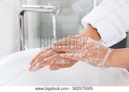 Coronavirus Pandemic Prevention Wash Hands With Soap And Warm Water. Rubbing Nails And Fingers Washi