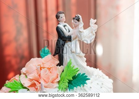 Confectionery Statuette Of The Newlyweds For The Cake.