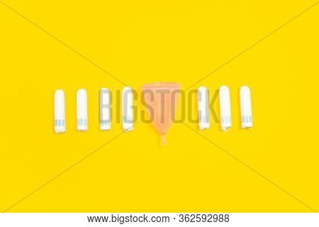 Tampons And Menstrual Cup. Eco-friendly Life - Organic Made Recycle Things In Compare With Polymers,