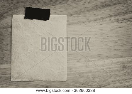 Vintage Of Blank Note Paper On Wooden Background And Copy Specs.