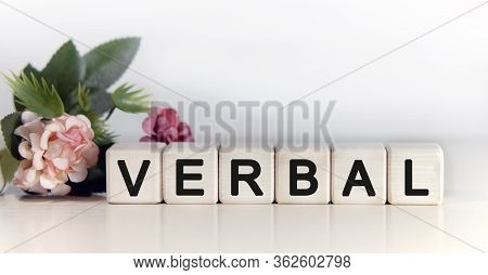 Verbal - Text On Wooden Cubes, Floral Background With Pink Tulips Green Plant
