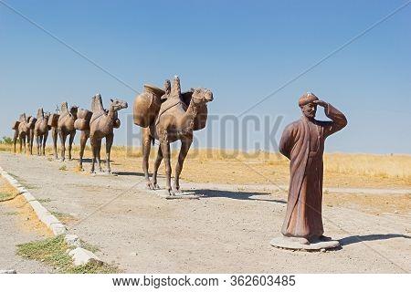 Turkestan, Kazakhstan - 04 August 2019. Monument Of A Caravan Of Camels Near Medieval Mausoleum Of K