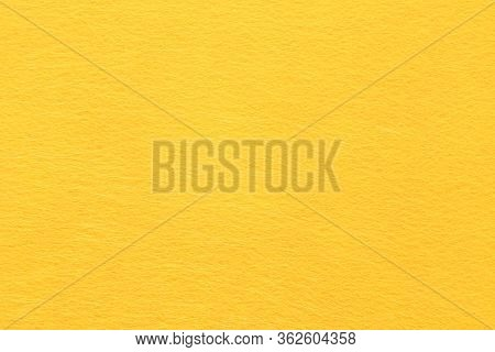 High Resolution Close Up Of Bright Yellow Felt Fabric Texture Of Rough Fleecy Fabric Of Yellow Color