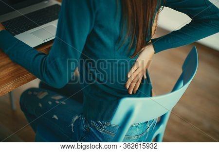 Close Up Of A Brunette Woman Massaging Her Back.
