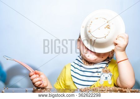 Funny Baby Eating. Little Baby Eating Dinner And Making A Mess