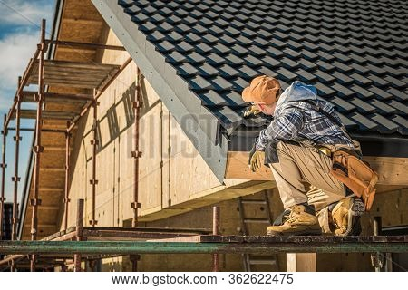 Roof Contractor Inspects Progress In New House Construction And Roof Installation.