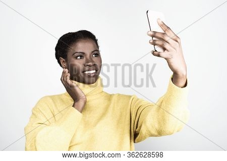 Beautiful African American Woman Taking Selfie With Smartphone. Attractive Young Lady Posing For Sel