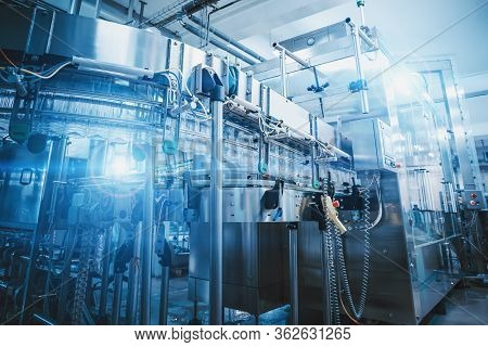 Industrial Factory Equipment In Futuristic Blue Lights, Conveyor Line, Industry Background, Toned