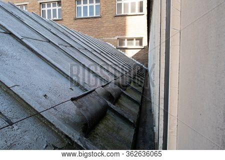 In An Old Factory With A Sloping Old Zinc Roof