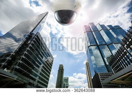 Outdoor Cctv Security Camera Installed On The Building Wall In The City. Cctv Security On The Buildi