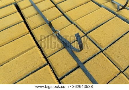 Paving Slabs, Paving Stones For Laying Paths, Stacked In Pallets Or Pallets. Used In The Road Indust