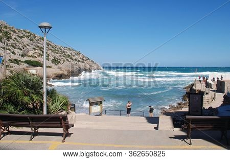 MAJORCA, SPAIN - NOVEMBER 2, 2018: Rough seas at Cala Barques in the resort of Cala San Vicente. The bay is one of four separate coves at the resort.