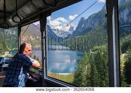 Gosau, Austria - July 4 2019: Gosaukammbahn Cable Car Over Vorderer Gosausee Lake Under Donnerkogel
