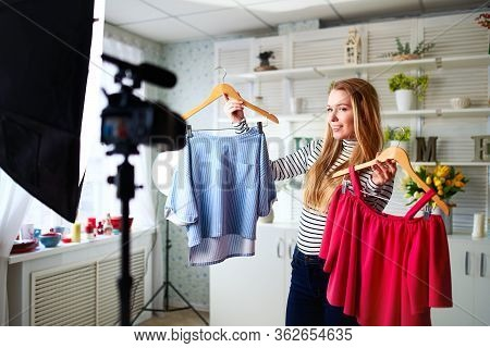Fashion Blogger Woman In Jeans And Turtleneck Showing Casual Colorful Shirts On Camera. Stylist Infl