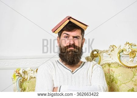 Macho Sits With Open Book On Head, Like Roof. Overwork Concept. Guy, Teacher Overdid With Teaching,