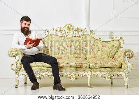 Humorous Literature Concept. Guy Reading Old Book With Enjoyment. Macho On Smiling Face Reading Book