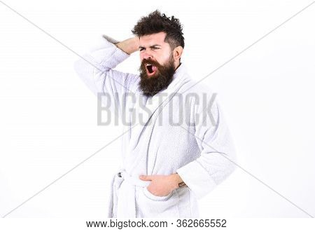 Man With Beard And Mustache Yawning While Scratching, Itching Head, Isolated On White Background. Gu