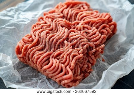The Minced Meat On The Cooking Paper And Stone Tray. Prefabricated Patties.