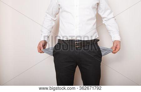 Empty  Pocket In Hands Of Man. Broke ,bankrupt Concept.bankruptcy